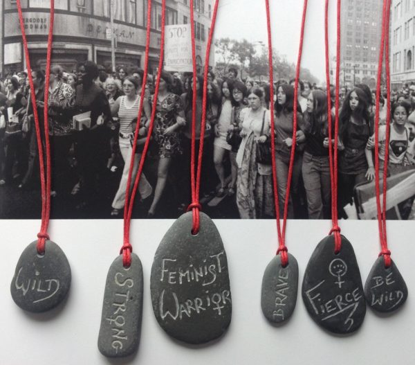 Red feminist pebble necklace collection