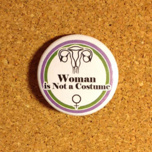 Woman is not a costume Badge